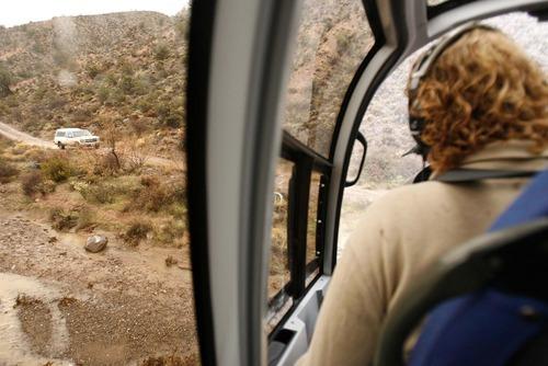 Trent Nelson  |  The Salt Lake Tribune Jeremy Johnson, piloting a helicopter, checks on the status of a motorist in Motoqua, Utah, Wednesday, December 22, 2010.