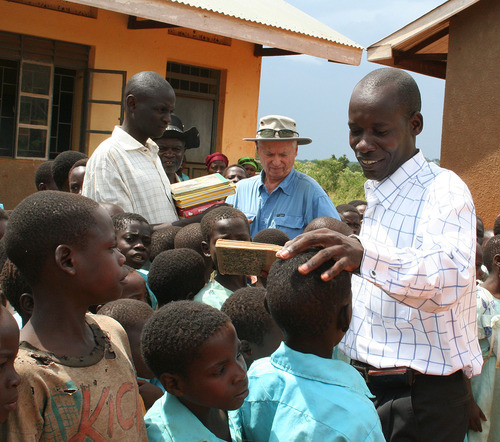 Jeremiah Stettler  |  The Salt Lake Tribune  SEEE Institute founder Bill Grenney delivers children's books to the Namatu Primary School along the shores of Lake Victoria. Before the delivery, the school had only two English titles for its 360 students.