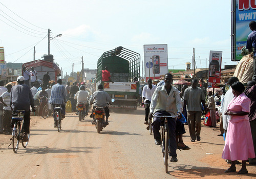 Jeremiah Stettler  |  The Salt Lake Tribune  In a crowded marketplace in eastern Uganda,  motorcycles, bicycles and delivery trucks share a narrow strip of dusty asphalt. Merchants peddle cement and cell phones and Coca Cola in hole-in-the-wall shops on either side.
