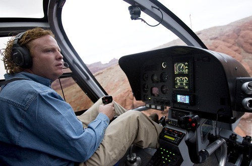 Djamila Grossman  |  The Salt Lake Tribune  Jeremy Johnson of St. George flies his helicopter Nov. 22 as part of a search to locate a man suspected of shooting state park ranger Brody Young near Moab. Johnson, who regularly volunteers in search efforts, went on an LDS mission to Missouri with Young.