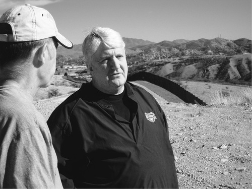 Thomas Burr  |  Tribune file photo  Rep. Rob Bishop speaks with Mark South, a former Forest Service firefighter, during a tour of the U.S.-Mexican border in Arizona in January.