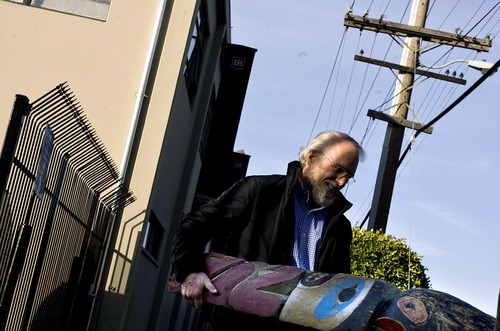 Djamila Grossman  |  The Salt Lake Tribune  John Warnock of Los Altos, Calif., carries a Nootka totem pole out of the Bonhams and Butterfields auction house in San Francisco, Monday, Dec. 6, 2010. Warnock bought the totem pole at a Native American art auction there.