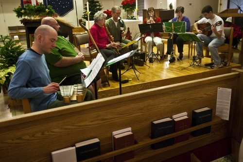 Chris Detrick  |  The Salt Lake Tribune  Members of the Sine Nomine Consort (L-R) Jay Jordan, Marlin Haws, Mary Johnson, Herald Clark, Vanessa Bridge, Lisa Chaufty and Spencer Young perform during a rehearsal at All Saints Episcopal Church in Salt Lake City Tuesday December 28, 2010.  The Sine Nomine Consort is an ensemble that performs Renaissance and Baroque music on period instruments, including recorders, viols and harpsichord, as well as vocal music.