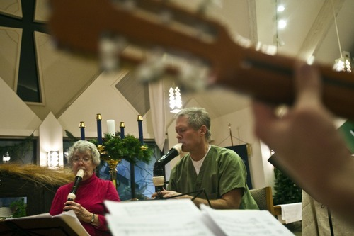Chris Detrick  |  The Salt Lake Tribune  Members of the Sine Nomine Consort (L-R) Mary Johnson, playing the recorder, and Herald Clark, playing the recorder perform during a rehearsal at All Saints Episcopal Church in Salt Lake City Tuesday December 28, 2010.  The Sine Nomine Consort is an ensemble that performs Renaissance and Baroque music on period instruments, including recorders, viols and harpsichord, as well as vocal music.