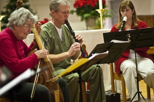 Chris Detrick  |  The Salt Lake Tribune  Members of the Sine Nomine Consort (L-R) Mary Johnson, playing the viola da gamba, Herald Clark, playing the recorder and Vanessa Bridge, playing the recorder, perform during a rehearsal at All Saints Episcopal Church in Salt Lake City Tuesday December 28, 2010.  The Sine Nomine Consort is an ensemble that performs Renaissance and Baroque music on period instruments, including recorders, viols and harpsichord, as well as vocal music.
