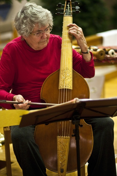 Chris Detrick  |  The Salt Lake Tribune  Mary Johnson, a members of the Sine Nomine Consort plays the viola da gamba during a rehearsal at All Saints Episcopal Church in Salt Lake City Tuesday December 28, 2010.  The Sine Nomine Consort is an ensemble that performs Renaissance and Baroque music on period instruments, including recorders, viols and harpsichord, as well as vocal music.