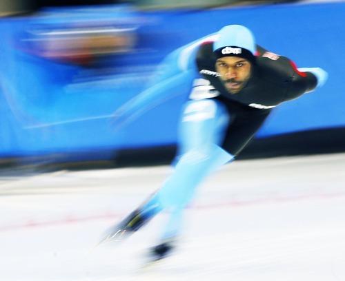 Steve Griffin  |  The Salt Lake Tribune   Shani Davis powers around a corner during the men's 5000 meter race at the U.S. Speedskating Championships at the Utah Olympic Oval in Kearns Thursday, December 30, 2010. Davis won the event.