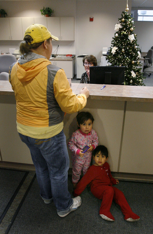 Steve Griffin  |  The Salt Lake Tribune   Two-year-old twins Amerie and Trace Delgado hide under the counter as their foster mom, Heather, reviews paperwork at the Weber-Morgan WIC clinic in Ogden. Heather is adopting the twins and qualifies for the WIC program, a supplemental food and nutrition education program for women, infants and children.
