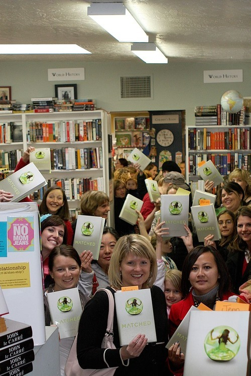 Fans of Utah young adult novelist Ally Condie line up for a peek at the author during a launch party for
