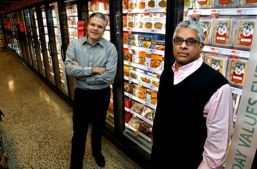 ** ADVANCE FOR USE MONDAY, DEC. 27, 2010 AT 12:01 A.M. AND THEREAFTER ** In this Dec. 14, 2010 photo, Jack Acree, executive vice president with American Halal Co., Inc., left, and Adnan Durrani, Chief Halal Officer with American Halal Co., Inc, stand near their products in a freezer case at a Whole Foods store in Darien, Conn. The company helped Whole Foods develop its first nationally distributed halal (Islamically permitted) food product called Saffron Road entrees that the food stores started selling in August. (AP Photo/Craig Ruttle)