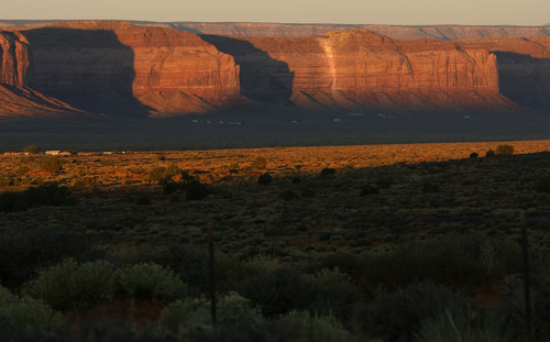 LEAH HOGSTEN   The Salt Lake Tribune A white line along the face of the Oljato Mesa in Monument Valley marks the Skyline uranium mine and its rubble piles that contaminate the land with dangerous radiation, just a few hundred feet from where Navajo residents have lived since the 1950s.