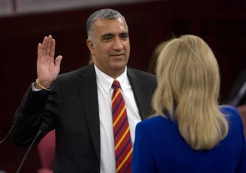 Al Hartmann  |  The Salt Lake Tribune  Newly elected District Attonrey Sim Gill takes the oath of office from Salt Lake County recorder Sherrie Swenson at a Salt Lake County Inauguration Ceremony on Monday.  He was among a dozen independent elected officials and Salt Lake County Council members  sworn in for the county.
