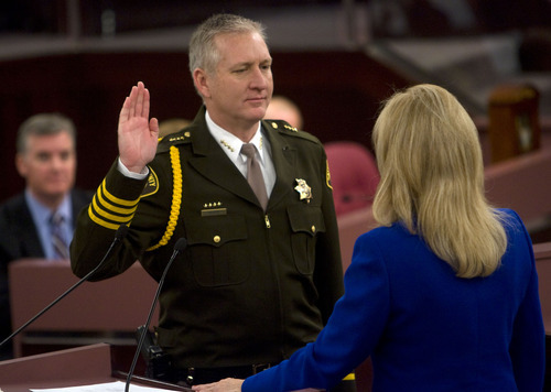 Al Hartmann  |  The Salt Lake Tribune  Incumbent Sheriff Jim Winder takes the oath of office from Salt Lake County recorder Sherrie Swenson at a Salt Lake County Inauguration Ceremony on Monday.  He was among a dozen independent elected officials and Salt Lake County Council members sworn in for the county.