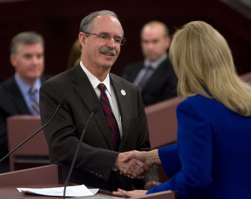 Al Hartmann  |  The Salt Lake Tribune  Salt Lake County Recorder Gary W. Ott is congratulated by recorder Sherrie Swenson at a Salt Lake County Inauguration Ceremony Monday morning.  He was among a dozen independent elected officials and Salt Lake County Council members  sworn in for the county on Monday January 3rd.