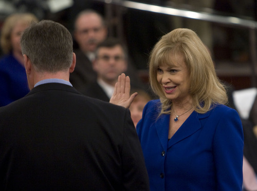 Al Hartmann  |  The Salt Lake Tribune  Long time Salt Lake County Recorder Sherrie Swenson takes the oath of office from Mayor Peter Corroon at a Salt Lake County Inauguration Ceremony Monday morning. She was among a dozen independent elected officials and Salt Lake County Council members  sworn in for the county on Monday January 3rd.
