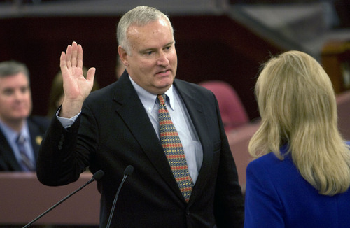 Al Hartmann  |  The Salt Lake Tribune  New Salt Lake County Council member Richard Snelgrove takes the oath of office from  recorder Sherrie Swenson at a Salt Lake County Inauguration Ceremony Monday morning.  He was among a dozen independent elected officials and Salt Lake County Council members  sworn in for the county on Monday January 3rd.