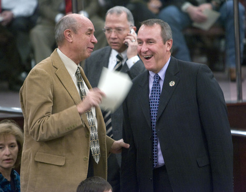 Al Hartmann  |  The Salt Lake Tribune  Utah Attoney General Mark Shurtleff, right, laughs at a conversation with retiring Salt Lake County Deputy Asessor Pete Lund Monday January 3rd at the Salt Lake County Council Chambers where a number of people took oaths of office.   Shurtleff appears in good spirits. He underewnt a colon cancer operation a few weeks ago.  He begins chemotherapy soon.