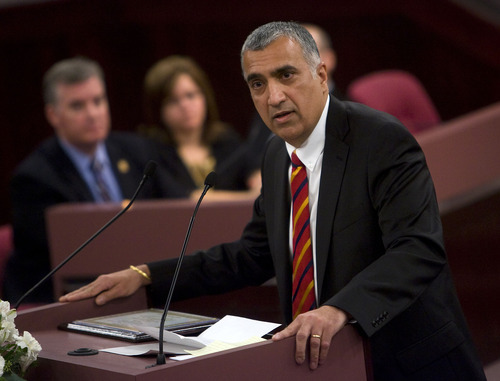 Al Hartmann  |  The Salt Lake Tribune  New Salt Lake District Attorney Sim Gill speaks to audience in Salt Lake County Council chambers after taking of oath of office Monday January 3rd.