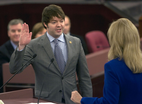 Al Hartmann  |  The Salt Lake Tribune  New member of the Salt Lake County Council Arlyn R. Bradshaw takes the oath of office from recorder Sherrie Swenson at a Salt Lake County Inauguration Ceremony Monday morning.  He was among a dozen independent elected officials and Salt Lake County Council members  sworn in for the county on Monday January 3rd.