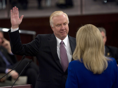 Al Hartmann  |  The Salt Lake Tribune  Salt Lake County Treasurer K. Wayne Cushing takes the oath of office from recorder  Sherrie Swenson at a Salt Lake County Inauguration Ceremony Monday morning.  He was among a dozen independent elected officials and Salt Lake County Council members  sworn in for the county on Monday January 3rd.