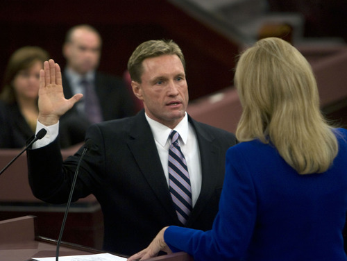 Al Hartmann  |  The Salt Lake Tribune  Salt Lake County Council member Steven L. DeBry takes the oath of office from recorder Sherrie Swenson at a Salt Lake County Inauguration Ceremony Monday morning.  He was among a dozen independent elected officials and Salt Lake County Council members  sworn in for the county on Monday January 3rd.
