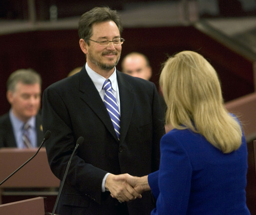 Al Hartmann  |  The Salt Lake Tribune  Salt Lake County Surveyor Reid J. Demman shakes hands with recorder Sherrie Swenson at a Salt Lake County Inauguration Ceremony Monday morning.  He was among a dozen independent elected officials and Salt Lake County Council members  sworn in for the county on Monday January 3rd.