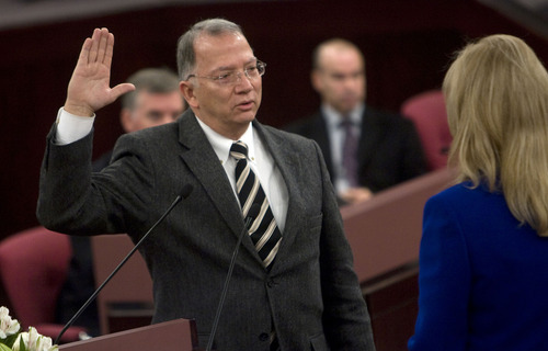 Al Hartmann  |  The Salt Lake Tribune  Salt Lake County Assessor Lee Gardner takes the oath of office from  recorder Sherrie Swenson at a Salt Lake County Inauguration Ceremony Monday morning.  He was among a dozen independent elected officials and Salt Lake County Council members  sworn in for the county on Monday January 3rd.