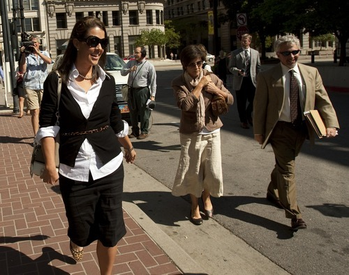 Chris Detrick  |  Tribune file photo Jericca Redd, left, Jeanne Redd, center, and defense attorney Mark Moffat walk away from the Federal Courthouse Sept. 16, 2009.  The mother and daughter duo from Blanding avoided prison time when they were sentenced in federal court Wednesday for illegally trafficking in American Indian artifacts. Federal Judge Clark Waddoups sentenced Jeanne Redd to 36 months of probation. Her daughter, Jericca Redd, received 24 months of probation and a $300 fine.