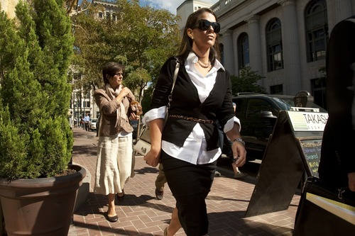 Chris Detrick  |  Tribune file photo Jericca Redd, right, and Jeanne Redd walk away from the Federal Courthouse Sept. 16, 2009. The mother and daughter duo from Blanding avoided prison time when they were sentenced in federal court Wednesday for illegally trafficking in American Indian artifacts. Federal Judge Clark Waddoups sentenced Jeanne Redd to 36 months of probation. Her daughter, Jericca Redd, received 24 months of probation and a $300 fine.