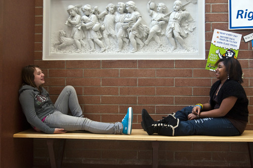 Chris Detrick  |  The Salt Lake Tribune  Sixth-graders Taya Robbinson, left, and Khadijha Martinez talk inside of the school during recess at Hawthorne Elementary in Salt Lake City on Tuesday, Jan. 4, 2011.  The Utah Department of Health advises schools to keep children sensitive to poor air, including those with asthma, indoors during recess.