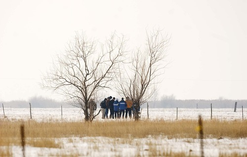 Trent Nelson  |  The Salt Lake Tribune Law enforcement officers investigate a field in Hooper where a man was fatally shot by police after a chase Tuesday, Jan. 4, 2011.