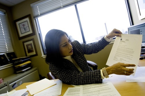 DJAMILA GROSSMAN   The Salt Lake Tribune Eunice Jones emigrated from the Philippines in 1986 and has been trying to get her sister naturalized since 2003. She recently found it might take another 15 years until her sister will be considered. Jones holds up a letter regarding her sister's immigration, at her Cottonwood Heights office.