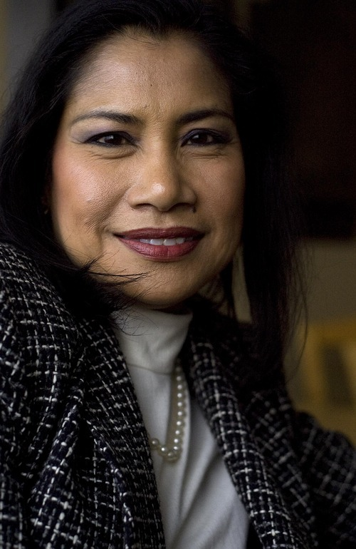 DJAMILA GROSSMAN   The Salt Lake Tribune Eunice Jones emigrated from the Philippines in 1986 and has been trying to get her sister naturalized since 2003. She recently found it might take another 15 years until her sister will be considered. Jones poses for a portrait at her Cottonwood Heights office.