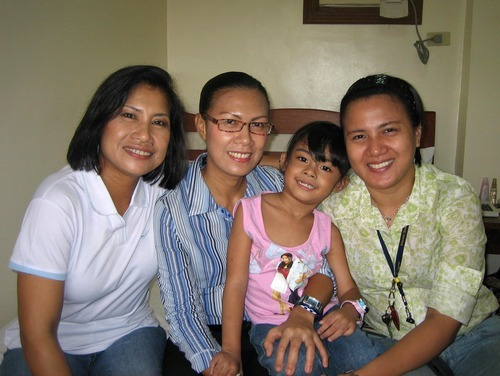 From left: Eunice Jones, her sister Myra Costales, her daughter Brenn, and Jones' other sister Emerald Guerra, pose for a portrait in the Philippines last January. Jones emigrated from the Philippines in 1986 and has been trying to get Emerald Guerra naturalized since 2003. She recently found out it might take another 15 years until her sister will be considered.  Courtesy Photo, Eunice Jones