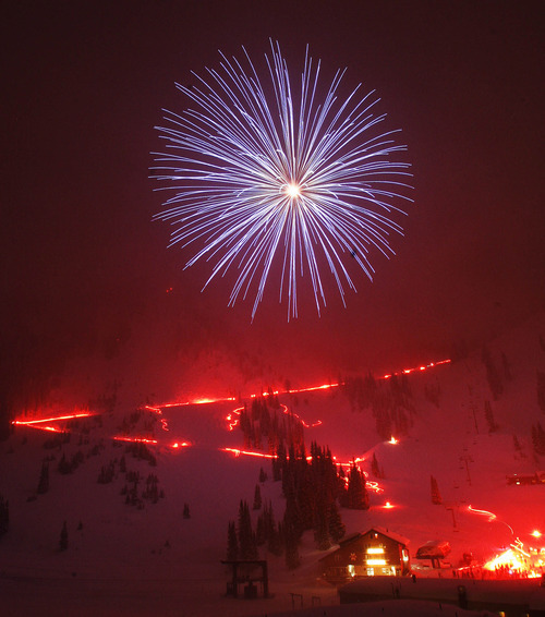 (file photo) Fireworks light up the snowy skies over Alta during the New Year's Torch Light Parade in 2005.