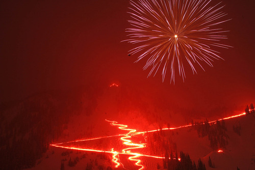 (file photo) Fireworks light up the snowy skies over Alta during the New Year's Torch Light Parade. Scores of skiiers traversed the slopes as part of the annual tradition. This year, no sulphur flares will be available. The resort will provide participants with a glow stick or flashlight with skiers encouraged to bring headlamps.