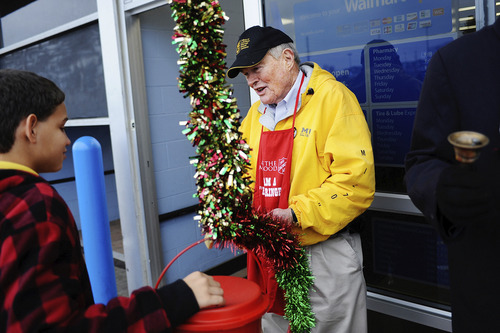 Joshua A. Bickel/Columbia (Mo.) Daily Tribune U.S. Sen. Kit Bond (R-Mo.), center, wishes William Richmond, 13, left, a Merry Christmas after Richmond donated to the Salvation Army while Bond was volunteering as a bell ringer Dec. 11, 2010, at a Wal-Mart in Columbia, Mo.