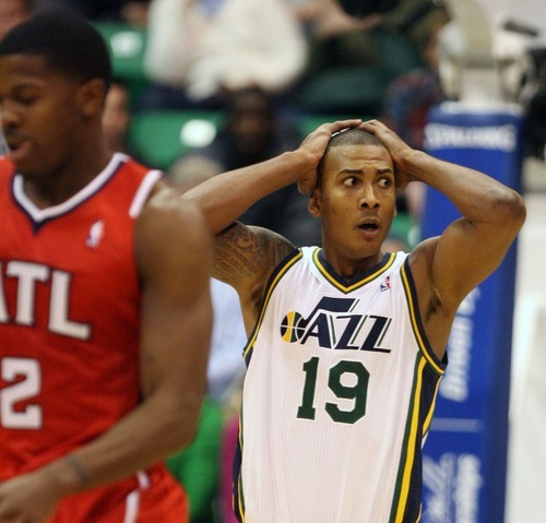 Steve Griffin  |  The Salt Lake Tribune   Utah Jazz guard Raja Bell holds his head in his hands after picking up a foul during first half action of the Jazz versus Hawks game at EnergySolutions Arena in Salt Lake City Wednesday, January 5, 2011.