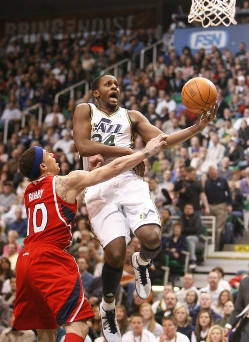 Steve Griffin  |  The Salt Lake Tribune   Utah's CJ Miles glides past Atlanta Hawks guard Mike Bibby on his way to the basket during second half action of the Jazz versus Hawks game at EnergySolutions Arena in Salt Lake City Wednesday, January 5, 2011.