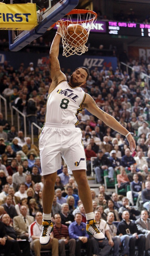 Steve Griffin  |  The Salt Lake Tribune   Utah Jazz guard Deron Williams slams the ball during first half action of the Jazz versus Hawks game at EnergySolutions Arena in Salt Lake City Wednesday, January 5, 2011.
