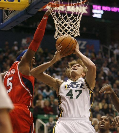 Steve Griffin  |  The Salt Lake Tribune   Utah Jazz forward Andrei Kirilenko gets fouled under the basket by Atlanta Hawks forward Josh Smith during first half action of the Jazz versus Hawks game at EnergySolutions Arena in Salt Lake City Wednesday, January 5, 2011.
