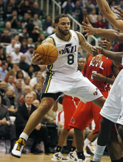 Steve Griffin  |  The Salt Lake Tribune   Utah Jazz guard Deron Williams passes out of trouble during first half action of the Jazz versus Hawks game at EnergySolutions Arena in Salt Lake City Wednesday, January 5, 2011.
