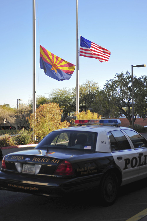 Flags fly at half-mast outside University Medical Center where Congresswoman Gabrielle Giffords was sent after being shot Saturday, Jan. 8, 2011, at a Safeway grocery store in Tucson, Ariz.  (AP Photo/Chris Morrison)