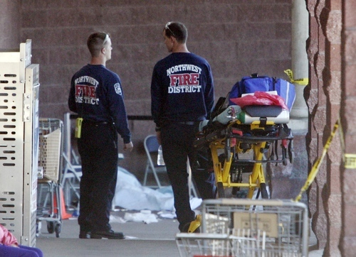 Emergency personnel work the scene of a shooting of Rep. Gabrielle Giffords, D-Ariz., and others in Tucson, Ariz., on Saturday, Jan. 8, 2011. (AP Photo/Arizona Daily Star, Dean Knuth)