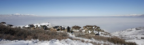 Steve Griffin  |  The Salt Lake Tribune   The Salt Lake Valley is blanketed by inversion as the sun shines on homes in the Suncrest neighborhood above Draper Friday, January 7, 2011.