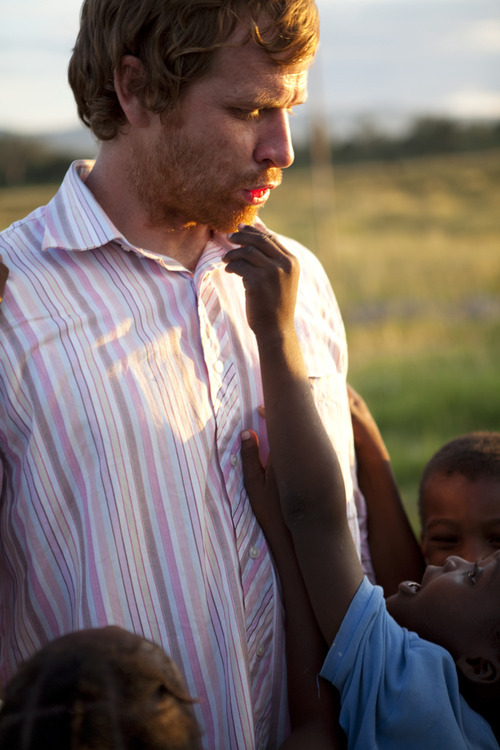 Former Logan School District teacher Matt Gunn (left) enjoying some free time with Haiti orphans who attend a school he helped build with financing from embattled Utah millionaire Jeremy Johnson.  Courtesy of Seth Smooth photography.