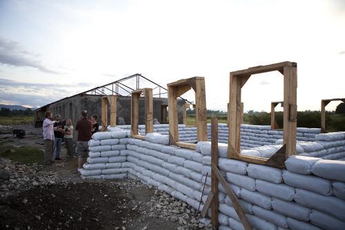 Former Logan School District teacher Matt Gunn (left) directing construction of an earth bag school in Haiti financed by embattled Utah millionaire Jeremy Johnson. Courtesy of Seth Smoot photography.