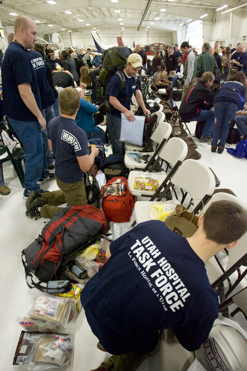 Steve Griffin  |  The Salt Lake Tribune  Salt Lake City -  Over 100 volunteers pack away their supplies as the group