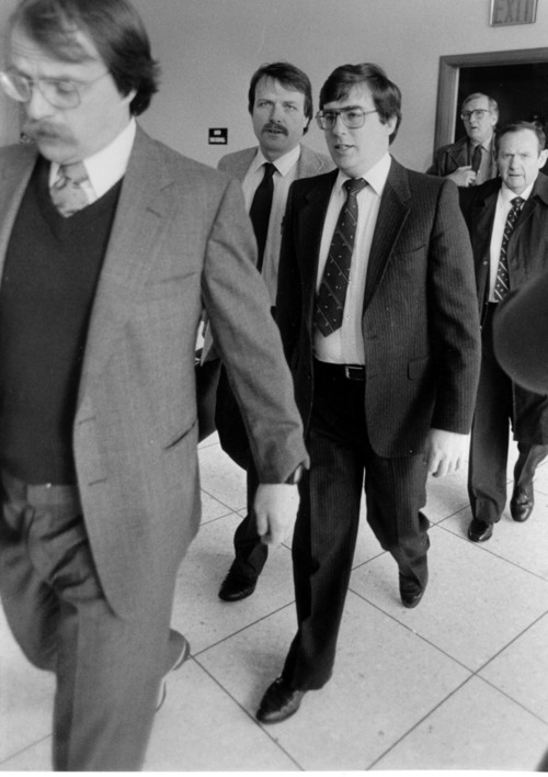 Mark Hofmann, glasses with tie, walks behind his attorney, Ron Yengich, mustache and glasses, at his trial. Photo taken by Al Hartmann, The Salt Lake Tribune