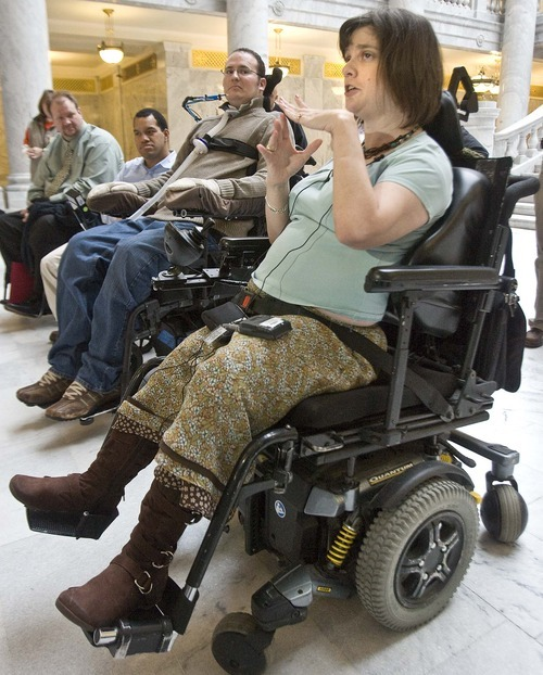 Paul Fraughton  |  The Salt Lake Tribune    At a press conference in the capitol rotunda,Cathy Garber talks about her experiences and difficulties  dealing with the State of Utah in regards to  receiving  services as a disabled individual.  The Disabled Rights Action Committee filed a complaint with  the justice department  which is going to investigate the groups allegations. Wednesday,January 12, 2011